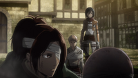 Hange asks Mikasa to meet up with Eren and Armin