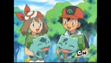 Ash and May with their Bulbasaur.