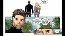 Peter and Felicia hold hands in front of Uncle Ben's grave.