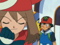 May is happy when Ash agrees to travel with her.
