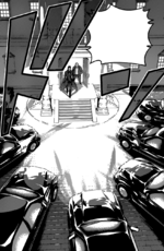 Azami surrounded by cars