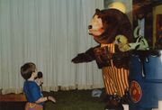 Child speaking with Billy Bob at ShowBiz Pizza in Fayetteville, Arkansas