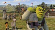 Shrek carrying lancelot