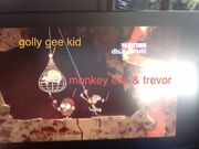 Monkey eric and trevor holding golly gee kid hostig