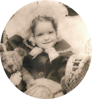 Clara Bow at three with a Teddy bear.