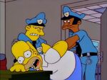Homer gets restrained by the police