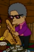 Lewis plays the sax