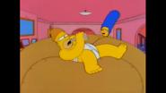 HomerIsLyingOnLardLadsColossalDonutAfterStealingItWhileDrinking