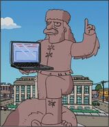 Jebediah Springfield statue with computer
