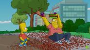 Barney snaps Bart's skateboard