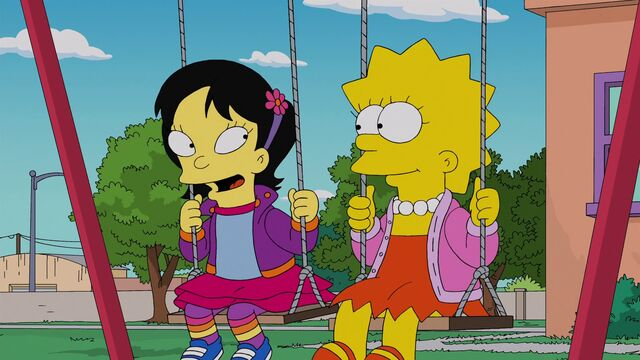File:Lisa and Tumi on the swings.JPG