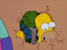 Homer comendo a casa de doces