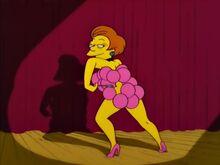 Edna Krabappel com balões no corpo extourando
