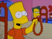 Bart holding Marge's pearl necklace
