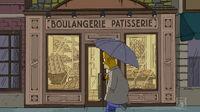 Homer przed francuską piekarnią