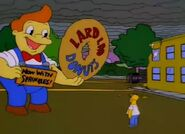 Lard Lad Tries To Distract Homer By Saying That His Donuts Now Have Sprinkles On Them