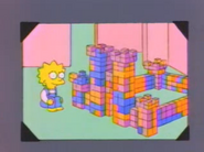 Lisa built a castle in a photo in And Maggie Makes Three
