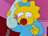 Maggie dials phone