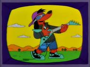 Poochie with guitar in the show
