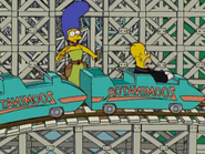 Homer and Marge at the Zoominator in the show