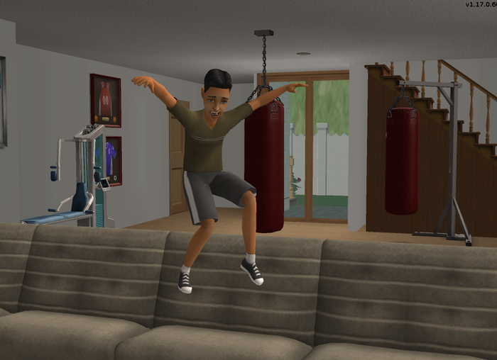 Evan Cuevas jumping on couch