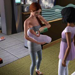 Una Sim alimentando a su bebé.