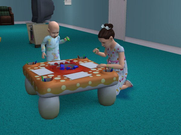 File:Lucinda drawing while Conner plays with blocks.jpg