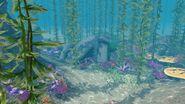 Скалистый риф пещера