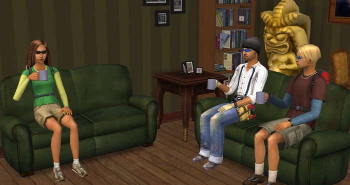The Travellers and Thomas Cuevas sipping coffee in their living room