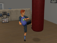 Garrett using the punching bag