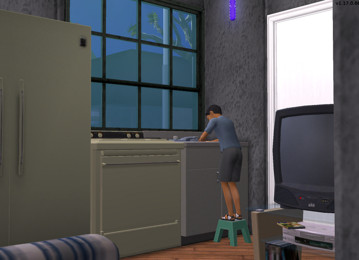 Lucas cleaning the kitchen sink