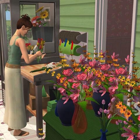 Un Sim haciendo ramos usando la <i>Estación de trabajo floral