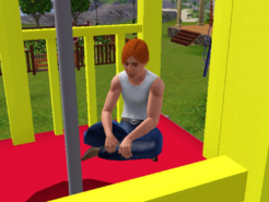 Maximus McDermott sitting on the playground tower