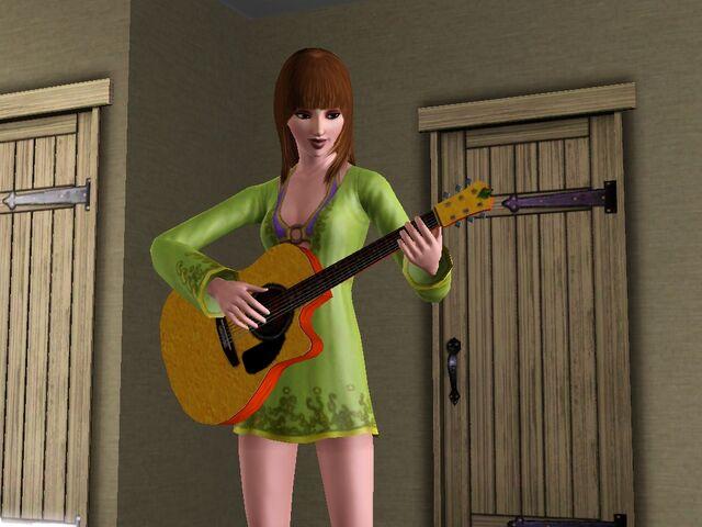 File:Singer playing guitar.jpg