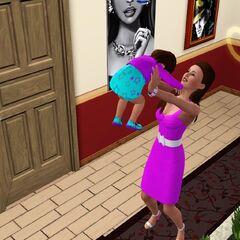 Una madre jugando con su hija infante.