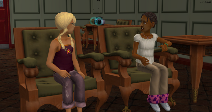 Tina and Lyndsay talking in the shelter of the indoors