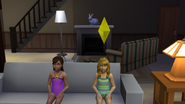 Julia and Jessica watch TV after a quick swim