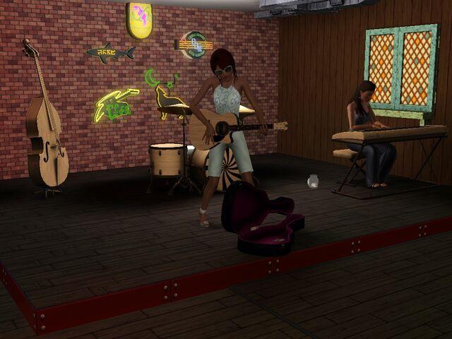 File:Sim playing guitar.jpg