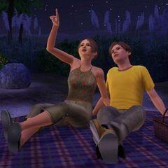 Dos jóvenes mirando las estrellas.