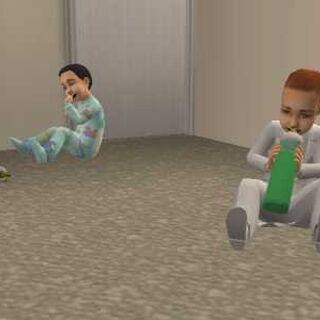 Un infante bebiendo de una botella.