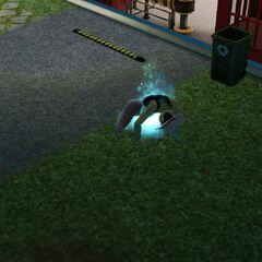 Un zombie saliendo del suelo.