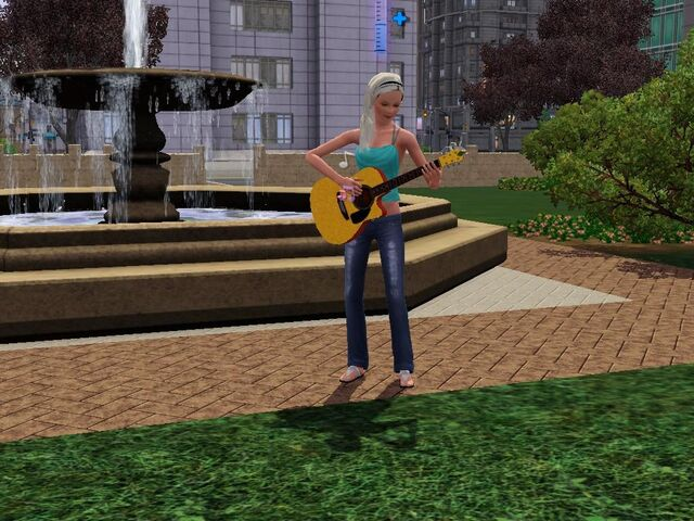 File:PlayingGuitarInThePark.JPG