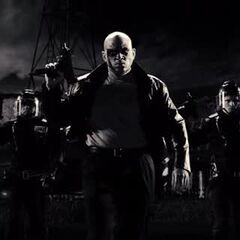 The Painted Cop (Ryan Rutledge) and his squad, armed with 9mm Micro Uzis.