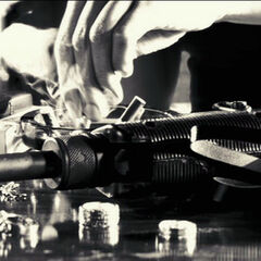 Gail puts out her mini-cigar with her Uzi on the table.