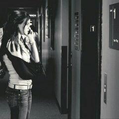 Waiting for the elevator door to open.