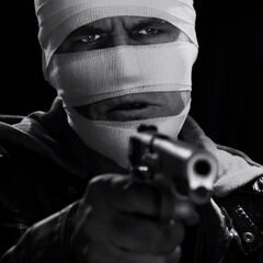 A post-facial surgery Dwight aims his gun.