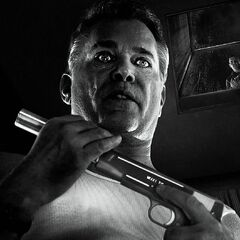 The suppressed Springfield Armory M1911A1 is seen in the hands of Joey (Ray Liotta).