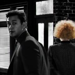 Johnny looks behind him.