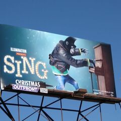 Johnny appears on a billboard promoting <i>Sing</i> (location unknown).
