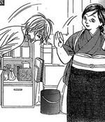 Kyoko bows to Okami-san